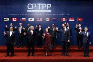 Representatives of the 11 countries pose for the family picture before signing the pact.