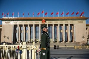 A People's Liberation Army soldier standing guard in Beijing yesterday. Chinese Foreign Minister Wang Yi said China was not a threat to the world, noting that the country was a leading contributor to global economic growth.