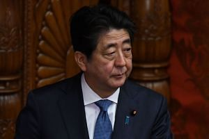 Japanese Prime Minister Shinzo Abe at the Upper House of Parliament in Tokyo on March 9, 2018.