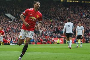 Marcus Rashford  celebrates scoring the second goal during their English Premier League match against Liverpool, on March 10, 2018.