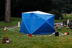 A tent used by police forensic investigators covers the grave of Alexander Skripal, son of former Russian spy Sergei Skripal, at the London Road cemetery in Salisbury, Britain, on March 9, 2018