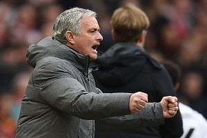 Mourinho gestures on the touchline during the match at Old Trafford.