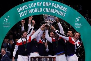 France celebrating with the trophy after winning the Davis Cup final at Stade Pierre Mauroy, Lille, last November. They overcame Belgium 3-2 in the 106th edition of the annual competition.