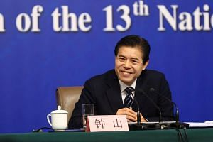Chinese Commerce Minister Zhong Shan said China does not want a trade war and will not initiate one.