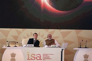 French President Emmanuel Macron and Indian Prime Minister Narendra Modi attend the founding conference of the International Solar Alliance in New Delhi on March 11, 2018.