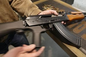 A bump stock installed on an AK-47.