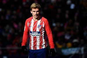 Atletico Madrid's French forward Antoine Griezmann reacts during the Spanish league football match between Atletico Madrid and Celta Vigo at the Wanda Metropolitan stadium in Madrid on March 11, 2018.
