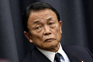 Japan's Finance Minister Taro Aso attending a press conference at the Ministry of Finance in Tokyo, Japan, on March 9, 2018.