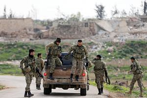 Turkish-backed Free Syrian Army fighters are seen in Maryamayn in eastern Afrin, Syria, on March 11, 2018.