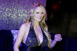 Stormy Daniels poses for pictures at the end of a striptease show in New York.