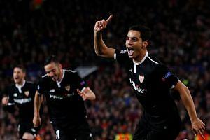 Sevilla's Wissam Ben Yedder celebrates scoring a goal.
