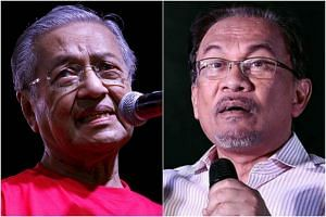 Malaysia's former prime minister Mahathir Mohamad (left) said he only had the power to sack his then deputy Anwar Ibrahim as deputy prime minister and finance minister.