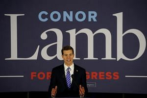 US Democratic congressional candidate Conor Lamb speaking during his election night rally in Pennsylvania's 18th U.S. Congressional district special election on March 13, 2018.