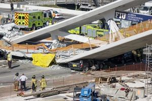 A view of the collapsed pedestrian bridge at the Florida International University in Miami.