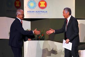 Australian PM Malcolm Turnbull (left) shakes hands with PM Lee Hsien Loong at the start of the Small-and-Medium sized Enterprises (SME) conference in Sydney, Australia, on March 16, 2018.