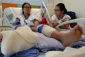 Zhong Si Ting and her friend, Chua Shan Shan, both 12, managed to escape without serious injuries, as they were between the wheels of the trailer.