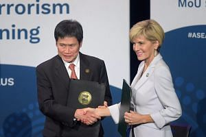 Australian Foreign Minister Julie Bishop and Asean Secretary-General Dato Lim Jock Hoi signed a Memorandum of Understanding to cooperate on fighting extremism and terrorism financing.