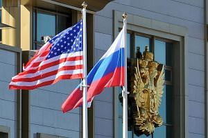 The flags of Russia and the US fluttering outside Moscow's Vnukovo Airport.