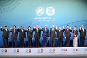 (From left) Laos' Prime Minister Thongloun Sisoulith, Indonesia's President Joko Widodo, Cambodia's Prime Minister Hun Sen, Brunei's Sultan and Prime Minister Sultan Bokliah, Thailand's Prime Minister Prayut Chan-O-cha, Australia's Prime Minister Mal