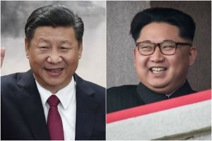 North Korean leader Kim Jong Un (right) has offered his congratulations to China's Xi Jinping upon his re-election as president.