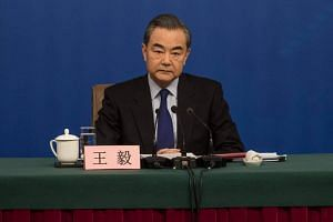 China's Foreign Minister Wang Yi attending a press conference during the First Session of the 13th National People's Congress in Beijing on March 8, 2018.