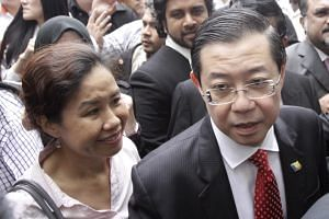 Penang Chief Minister Lim Guan Eng and his wife Betty Chew outside a court in Penang on June 30, 2016.