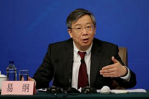 Deputy central bank governor of the People's Bank of China Yi Gang at a news conference during the ongoing National People's Congress (NPC), on March 10, 2017.