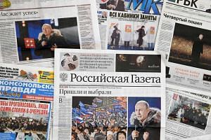 Front pages of Russian newspapers reporting on the victory of Vladimir Putin in Russia's presidential election on March 19, 2018.