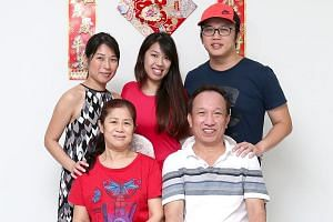 The Oh family at home on June 26, 2017. (Back row from left) Ms Oh Hui Ping, Ms Oh Hui Shan and Mr Oh Zhi Long. (Front row from left) Madam Seng Kiah Eng and Mr Oh Han Kok.