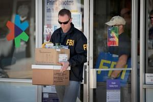 FBI agents collect evidence at a FedEx Office facility following an explosion at a nearby sorting center in Sunset Valley, Texas on March 20, 2018.