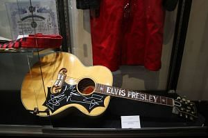 Elvis Presley's limited edition Gibson EJ-200E guitar at Heritage Auctions in Beverly Hills, California.