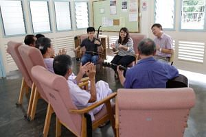 Volunteers sing songs with tuberculosis patients in  Tan Tock Seng Hospital. Of the 1,536 new cases reported among Singapore residents in 2017, two in three were 50 years old and above.