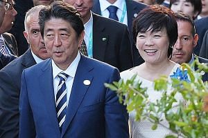 Prime Minister Shinzo Abe and his wife Akie arriving for a concert at the ancient Greek Theatre of Taormina during the Group of Seven summit in Sicily, Italy, last May.