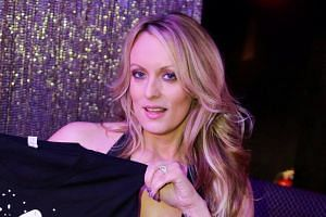 Adult-film actress Stephanie Clifford, also known as Stormy Daniels, poses for pictures at the end of her striptease show in Gossip Gentleman club in Long Island, New York, on Feb 23, 2018.