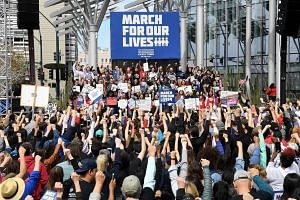 Protesters at the March For Our Lives rally on Saturday in Las Vegas, where a gunman killed 58 people at a country music festival last year. More than 800 demonstrations were scheduled in the US and overseas, said coordinators, with events as far as