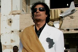 The death of former Libyan dictator Muammar Qaddafi (pictured) has held different implications for the US administration and North Korean leader Kim Jong Un.