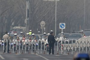 The motorcycle-riding presidential guard leads the motorcade of a high-ranking North Korean near the Diaoyutai State Guesthouse in Beijing on March 27, 2018.