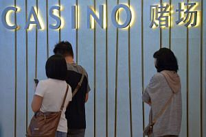 File photo showing people outside the casino at Marina Bay Sands in Singapore.