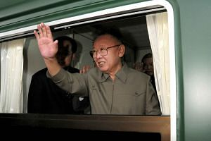 This file picture taken on May 7, 2010, shows North Korean leader Kim Jong-Il waving from a train while leaving Beijing after a five-day visit to China.