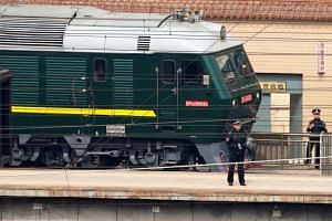 The train spotted in Beijing - 21 cars painted drab green, their windows tinted to obscure the identities of those on board - bore the hallmarks of the bulletproof private transports preferred by the mistrustful leaders of North Korea.