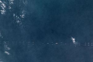 A satellite photo shows Chinese ships south of Hainan, China on March 26, 2018.