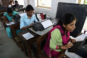 Candidates use typewriters during the last official typing exam conducted by the state government in Mumbai on Aug 7, 2017.