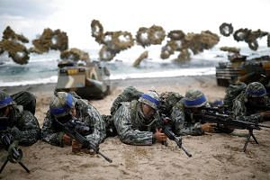 South Korean marines take part in a US-South Korea joint landing operation drill as a part of the two countries' annual military training called Foal Eagle, in Pohang, South Korea, on April 2, 2017.