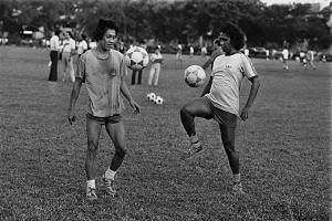 Local football greats Dollah Kassim (right) and Quah Kim Lye training at the Farrer Park Athletic Centre in 1983.