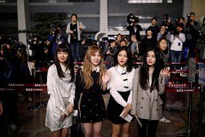 Members of South Korean K-pop girl group Red Velvet leaving for Pyongyang at the Gimpo International airport in Seoul, South Korea, on March 31, 2018.