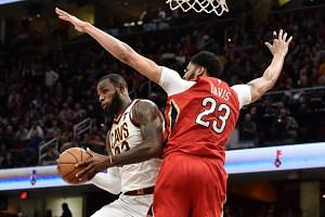 Cleveland Cavaliers forward LeBron James (right) drives to the basket against New Orleans Pelicans forward Anthony Davis during the second half at Quicken Loans Arena.