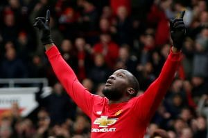 Lukaku celebrates scoring their first goal.