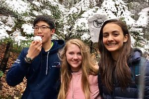 Fencer Amita Berthier (right), hiking with her friends during winter in Boston, Massachusetts, where she is now based.