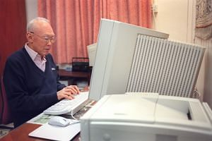 The late Mr Lee Kuan Yew working on the drafts for his memoirs in his Oxley Road home.