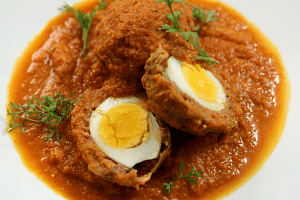 Nargisi kofta are hard-boiled eggs coated with minced meat and then cooked in gravy.
